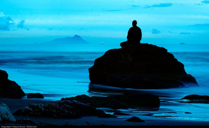 meditating-spiritual-man-on-sea-rock