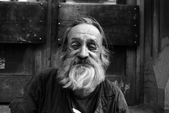 homeless man black and white